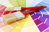 foto of interior decorator  - closeup of color guide sampler and paint brush - JPG