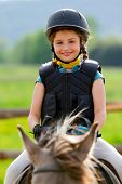 Horse riding, portrait of lovely equestrian on a horse