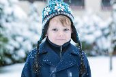 Little Toddler Boy Having Fun With Snow Outdoors On Beautiful Winter Day.