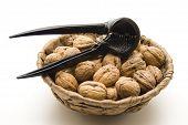 Walnuts with black nutcracker