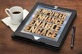 empower, enhance, enable and engage - motivational business concept - a collage of words in letterpr