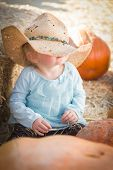 pic of baby cowboy  - Adorable Baby Girl with Cowboy Hat in a Country Rustic Setting at the Pumpkin Patch - JPG