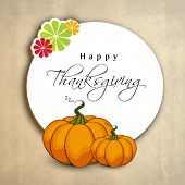 Happy Thanksgiving Day tag, sticker or label with pumpkin and maple leaves for your messages or wishes.