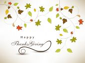 Happy Thanksgiving Day background with colorful maple leaves on grey background.