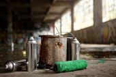 stock photo of spayed  - Spray Cans and Painting Graffiti Kit Leftover on the ground  - JPG