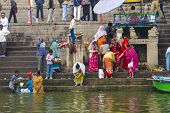 Hindu People Wash Themselves In The River Ganga In The Holy City Of Varanasi
