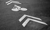 White Bicycle Lane Label And Arrows On The Asphalt Road