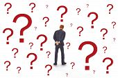 stock photo of figurine  - Figurine from Manager with question mark on bright background - JPG