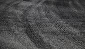 Dangerous Turn. Abstract Road Background With Tires Tracks On Asphalt