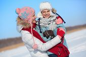 Happy woman and her son in winterwear