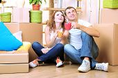 stock photo of penthouse  - Young couple celebrating moving to new home - JPG