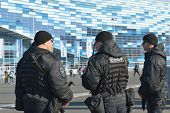 SOCHI, RUSSIA - FEBRUARY 12, 2014: Soldiers of SOBR protect a law and order in the Olympic park during Winter Olympics. SOBR is the special group of fast reaction used in antiterroristic operations