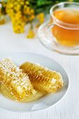Honey Combs With Honey And Tea