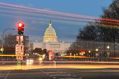 Capitol building night view from Pennsylvania Avenue with car lights trails - Washington DC, United States