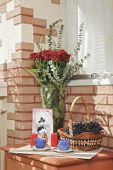 Sunny Composition With Rose Bouquet And Fruit Basket On The Bedside Table poster