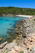 Platja des Bot beach at Algaiarens cove in sunny day, Menorca island, Spain