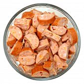 stock photo of chipotle  - Spicy Cheese Filled Chipotle Sausages Chopped in Bowl Over White - JPG
