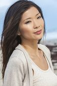 Outdoor portrait of a beautiful young Chinese Asian young woman or girl