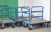 stock photo of self-storage  - Trolleys at self storage centre with blue handles - JPG