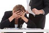 stock photo of yell  - Cruel boss bullying hard working for him woman - JPG
