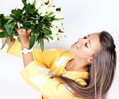 Pretty Brunet Woman Holding Bunch Of Roses