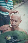 PHANGNGATHAILAND FEBRUARY 08 :Thai man gets his head shaved by a monk during a Buddhist ordination c