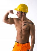 Muscular Young Construction Worker Shirtless Looking At His Bulging Bicep
