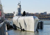 picture of icbm  - photo capture of a docked submarine at a pier - JPG