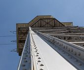 Metal designs of a tower of a ropeway in Barcelona, perspective view