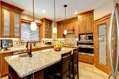 picture of stool  - Luxury kitchen with light brown cabinets steel appliances pantry marble counter top island - JPG