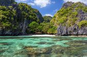 Clear sea water and white beach in the Miniloc island, El Nido, Philippines