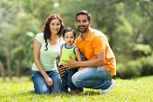 stock photo of indian  - portrait of happy indian family outdoors - JPG