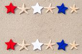 stock photo of veterans  - American holidays background with starfishes and color stars on the sand - JPG