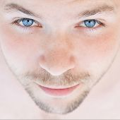 pic of piercings  - Close up of mans portrait with piercing blue eyes - JPG