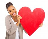 cheerful african american girl with heart shape against white background