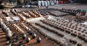 pic of pottery  - Newly made pottery drying in the sun at the Pottery Square of one of Nepals five king cities - JPG