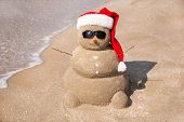 Christmas sandy Snowman at beach. Holiday New Year concept