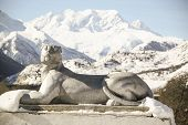 stock photo of snow-leopard  - Stone sculpture of a leopard on a background of snow mountains  - JPG