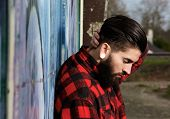 Young Man With Beard And Piercings Outdoors