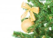 Christmas Tree Branch With Golden Decorations Background