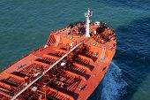 Large Red Cargo Ship Driving On Deep Blue Ocean
