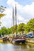 image of pontoon boat  - old boats in a canal in Harlingen - JPG