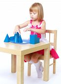 image of montessori school  - Little girl playing pyramid sitting at the table Montessori school - JPG