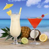 stock photo of pina-colada  - Cocktails and alcohol drinks like Pina Colada and Martini on the beach - JPG