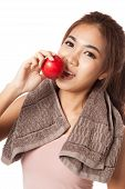 picture of love bite  - Asian healthy girl smile bite red apple isolated on white background - JPG