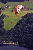 foto of parachute  - Extreme parachuting in high mountains Alps Austria  - JPG