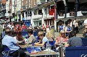Pavement cafe along Bridge Street, Chester.