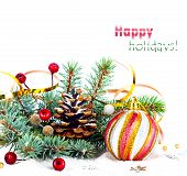 Christmas Tree Branch With Gold Serpentine And Pink Sphere On White Background Isolated
