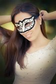 Young Woman Putting on a Mask