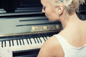 Portrait Of Woman Playing On The Retro Style Piano